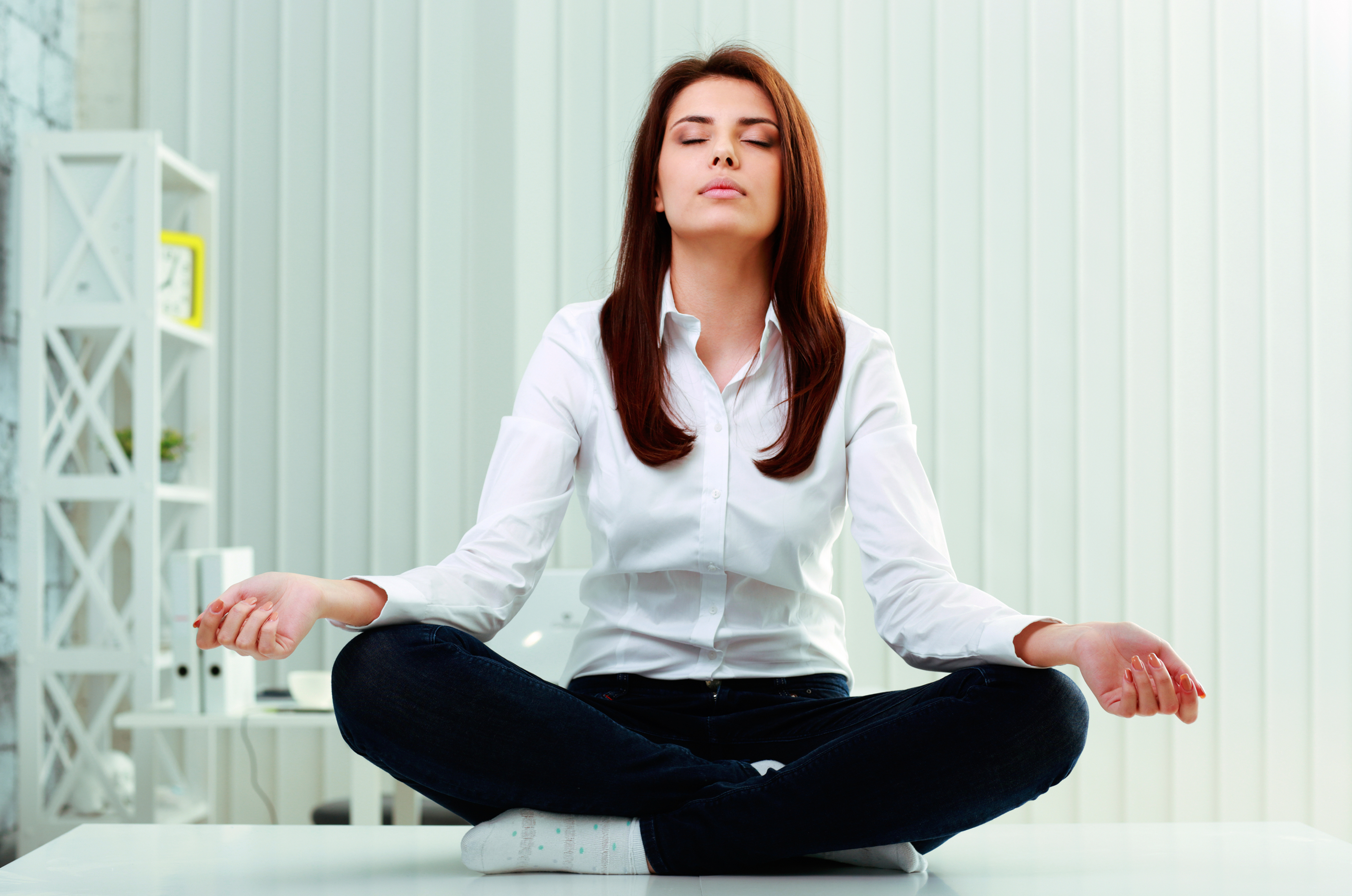 meditation office. women meditates in office meditation d